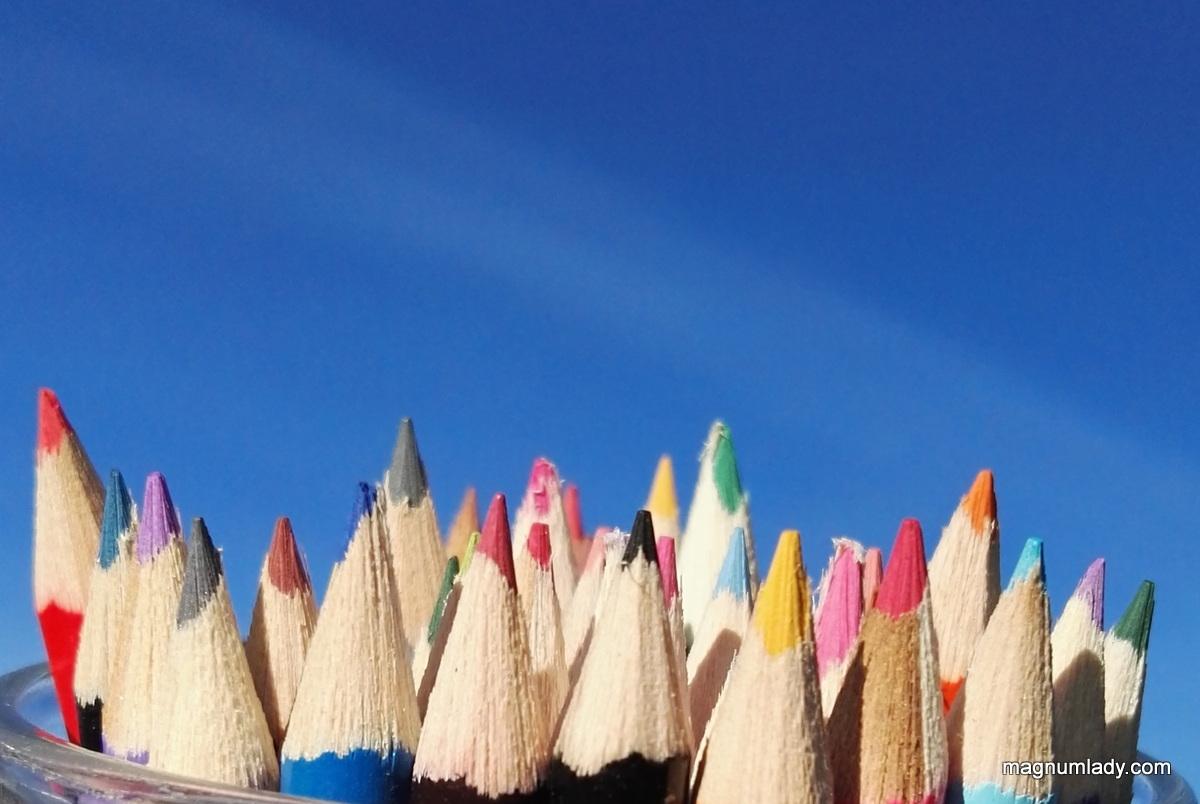 Coloured pencils and a blue sky
