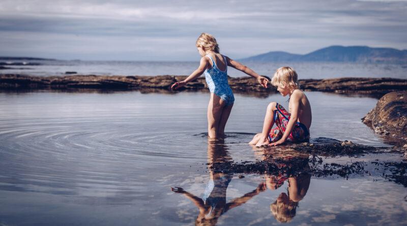 children swimming in the atlantic