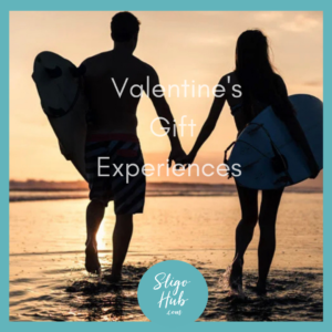 couple in love surfing in sligo for valentines